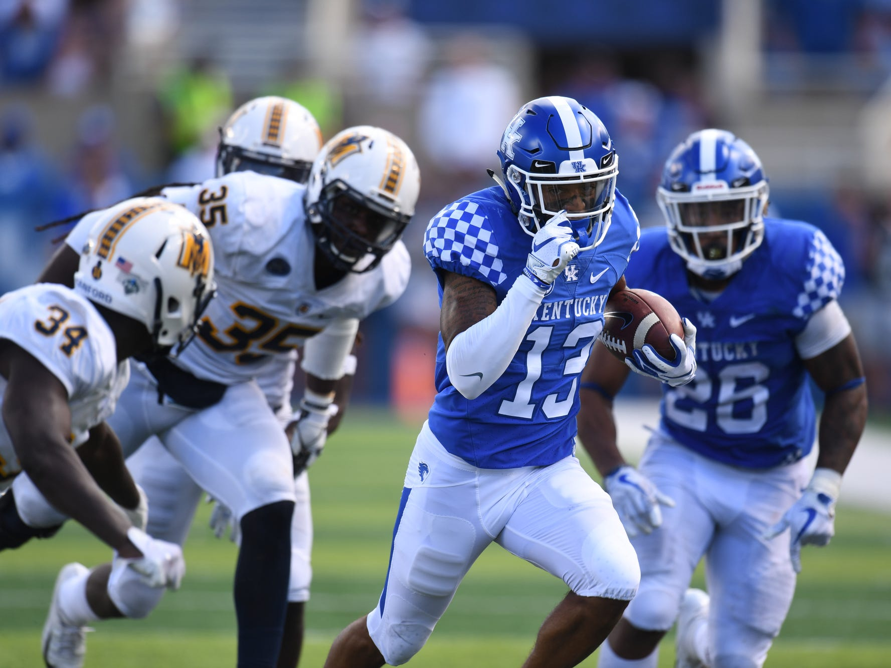 UK wide receiver Zy'Aire Hughes scores a touchdown on a double reverse during the University of Kentucky football game against Murray State at Kroger Field in Lexington, Kentucky, on Saturday, Sept. 15, 2018.