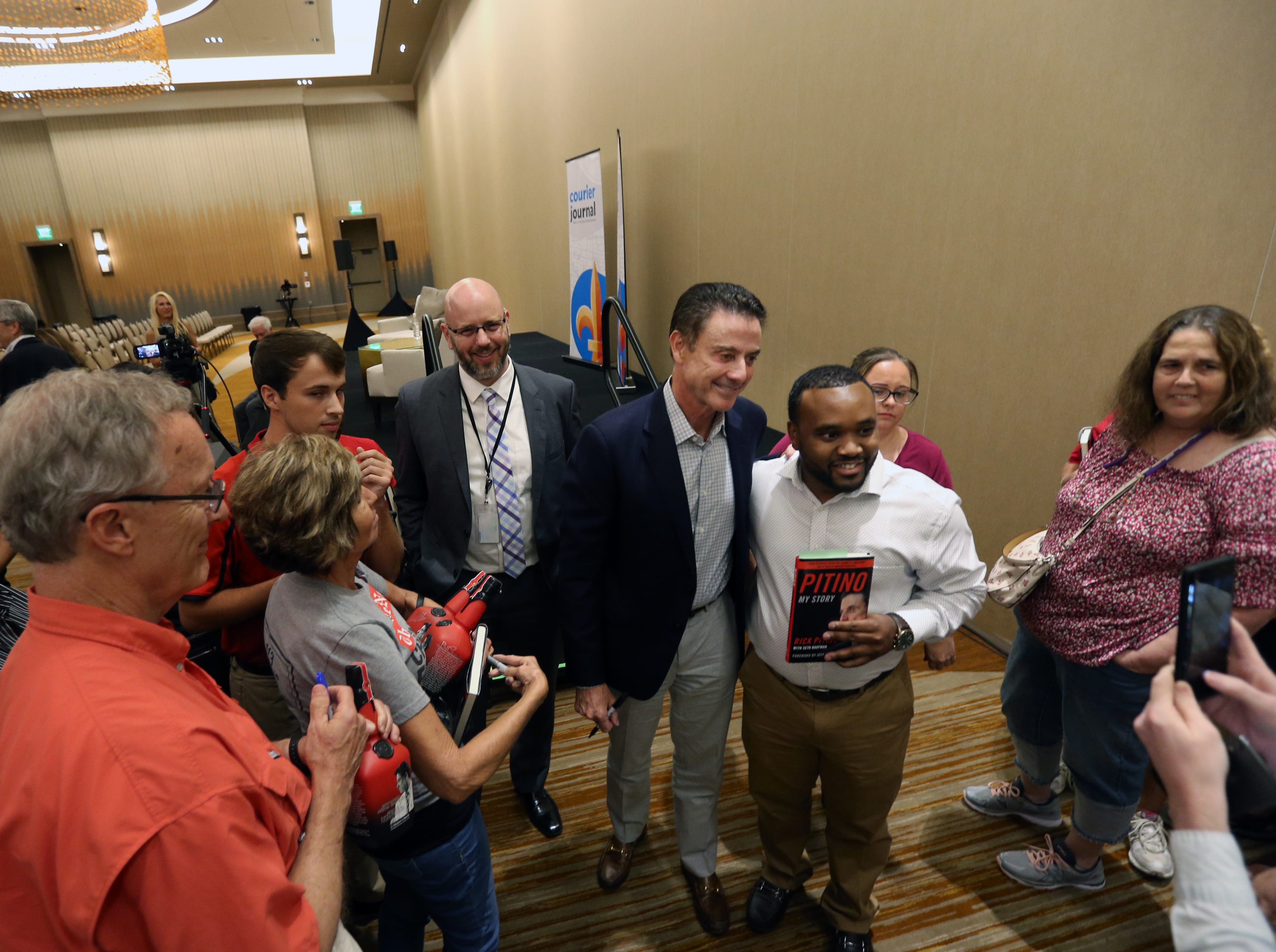 Rick Pitino stays after the livestream show with the Courier Journal to take pictures and sign autographs for the fans at the Omni Hotel on Friday in Louisville, Kentucky.Sept. 14, 2018