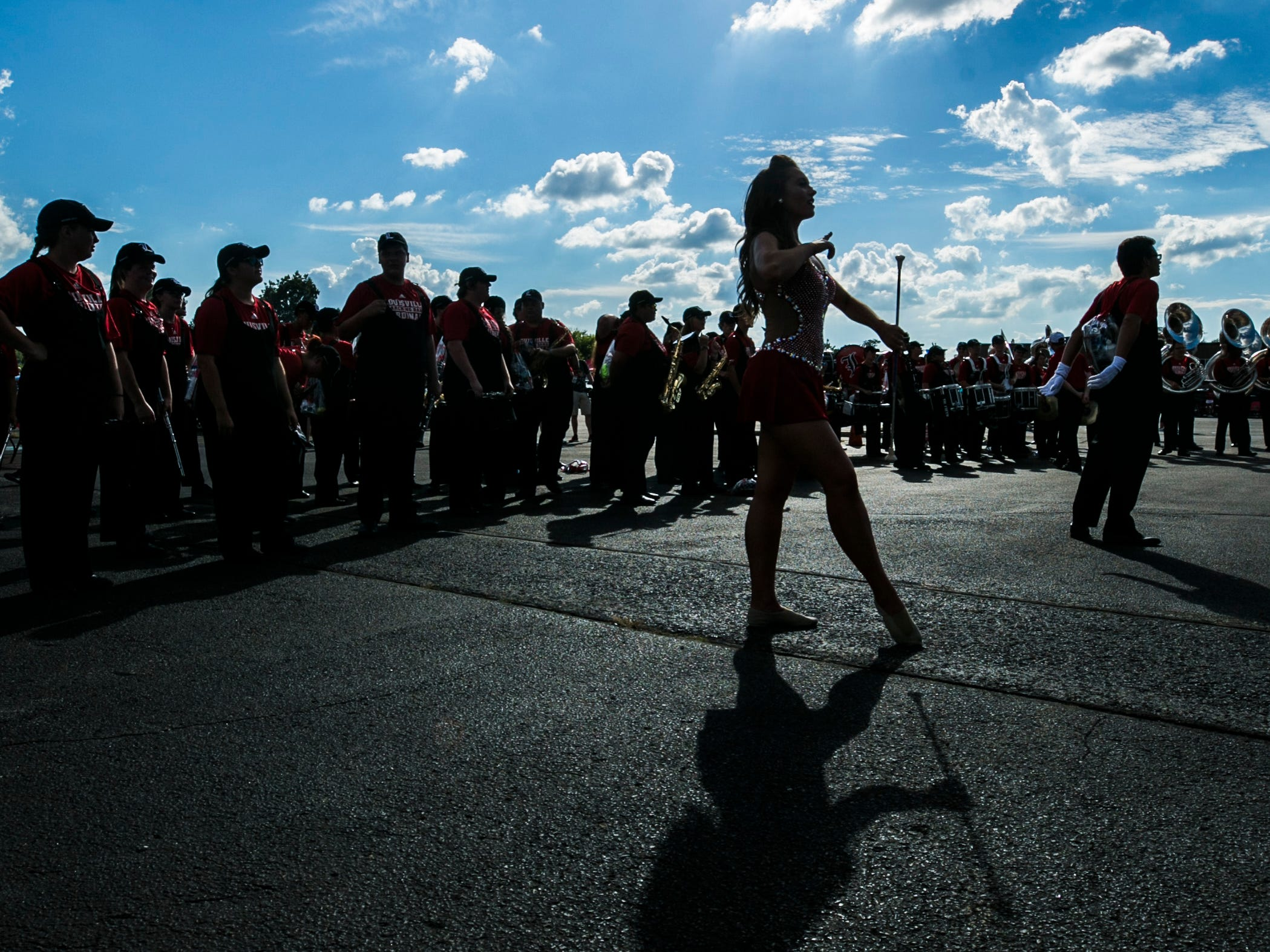 A U of L baton twirler stands near the band before the Cardinals' game against Western Kentucky Saturday, Sept. 15, 2018.