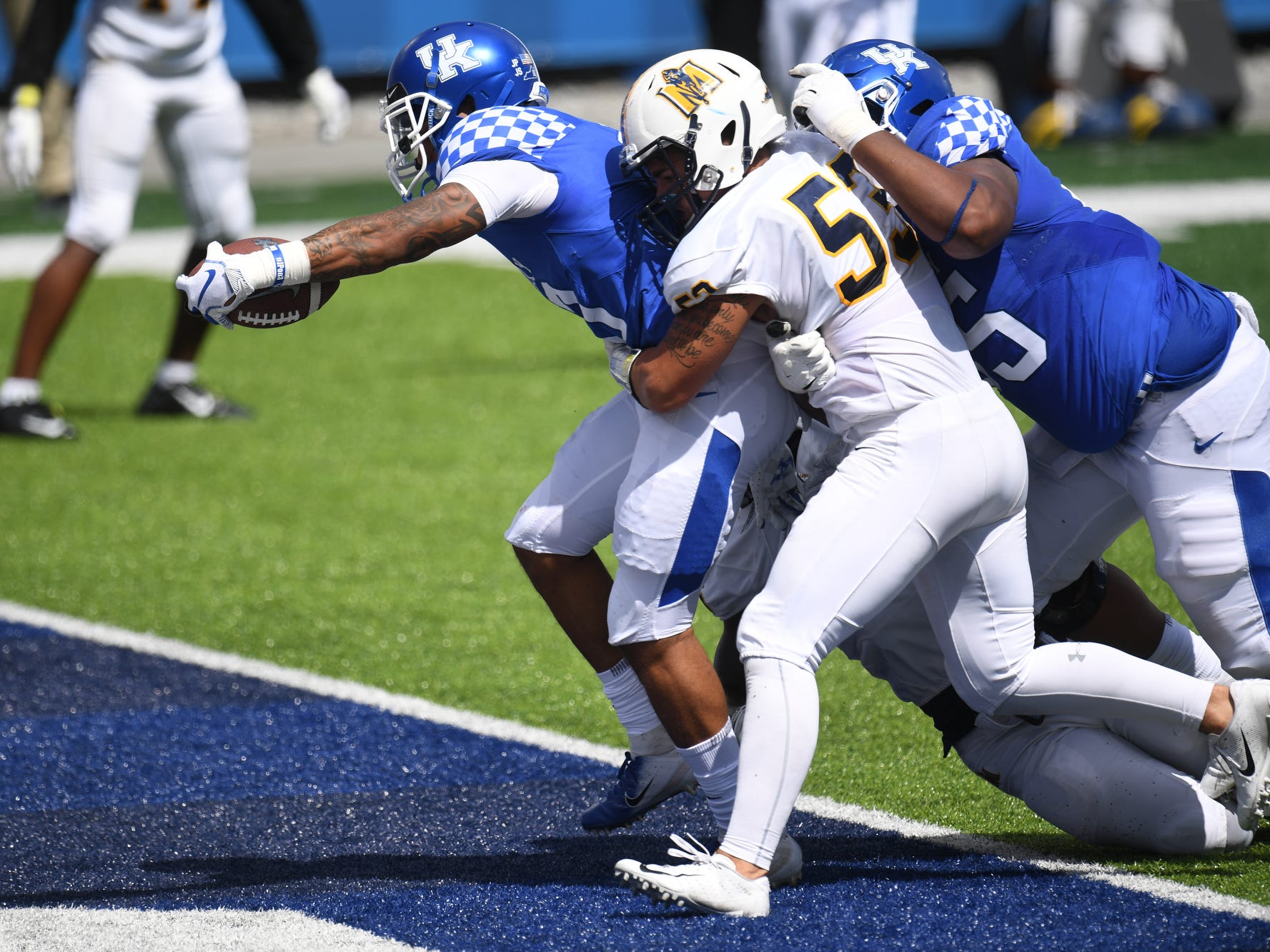 UK running back A.J. Rose scores a touchdown during the University of Kentucky football game against Murray State at Kroger Field in Lexington, Kentucky, on Saturday, Sept. 15, 2018.