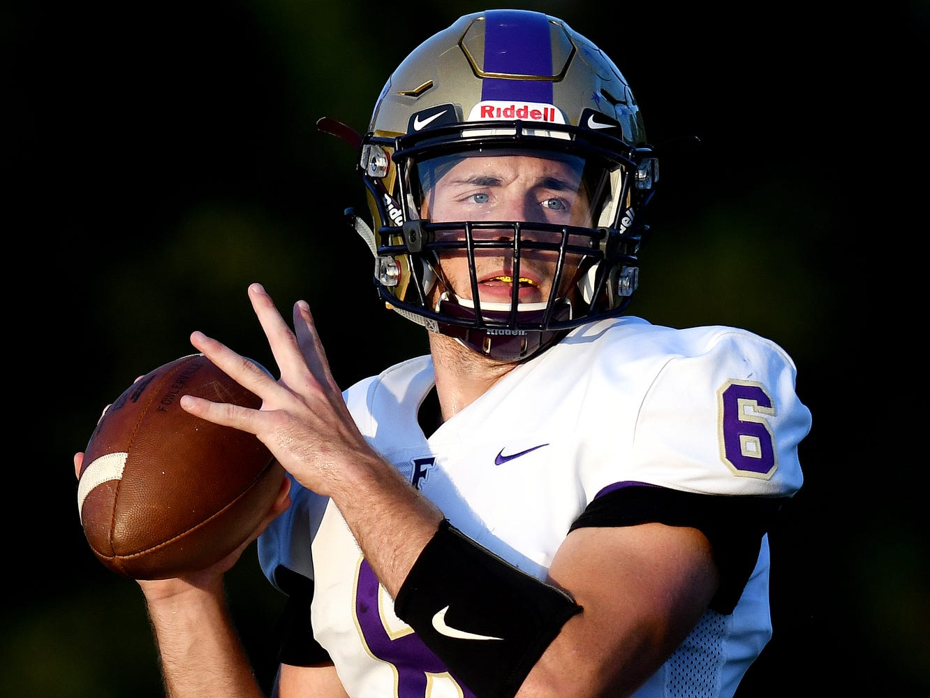 Fowlerville's quarterback Geoffrey Knaggs looks to throw during the first quarter on Friday, Sept. 14, 2018, at Haslett High School.