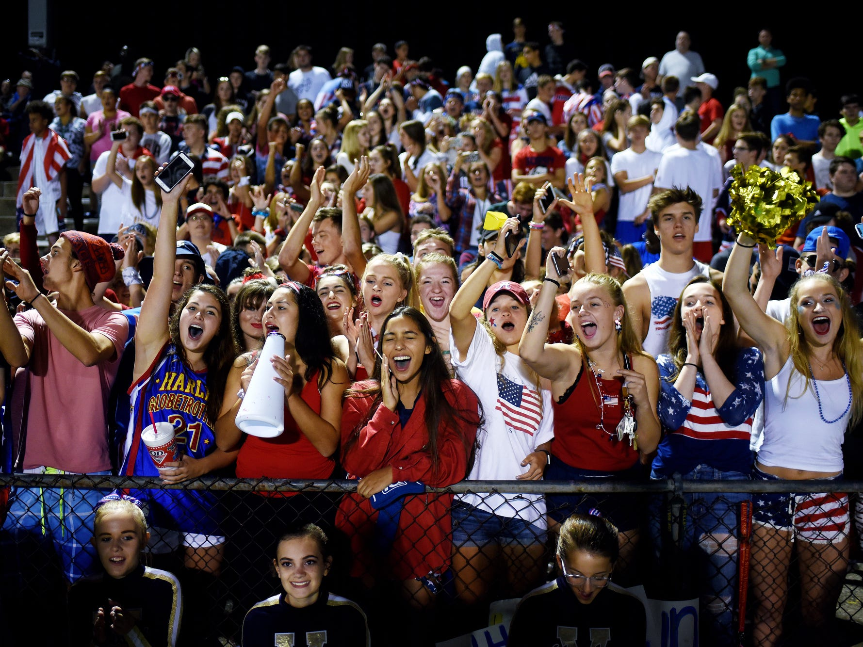The Haslett student section cheers during the third quarter on Friday, Sept. 14, 2018, at Haslett High School.