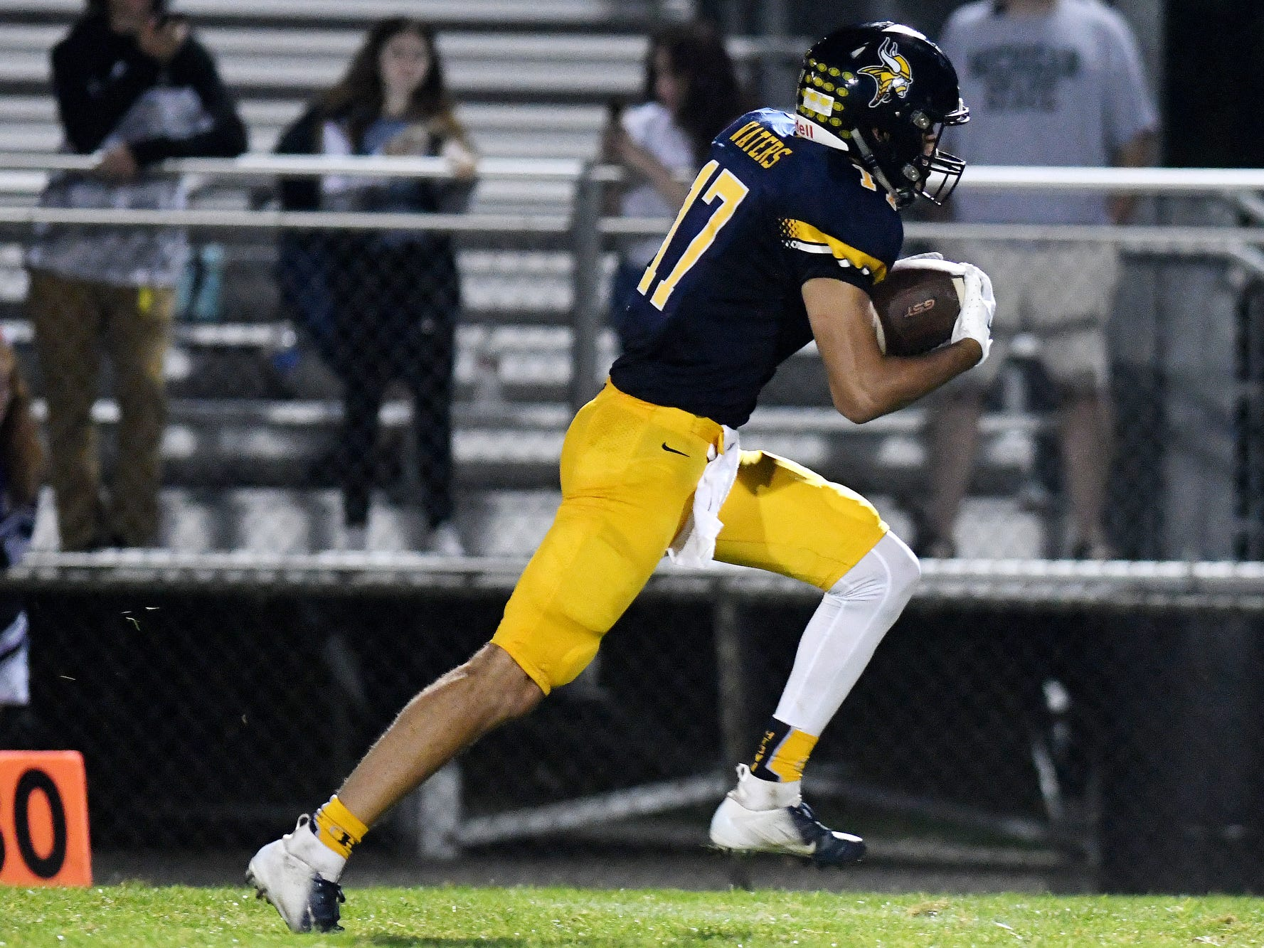 Haslett's Andrew Waters catches a touchdown pass during the third quarter on Friday, Sept. 14, 2018, at Haslett High School.