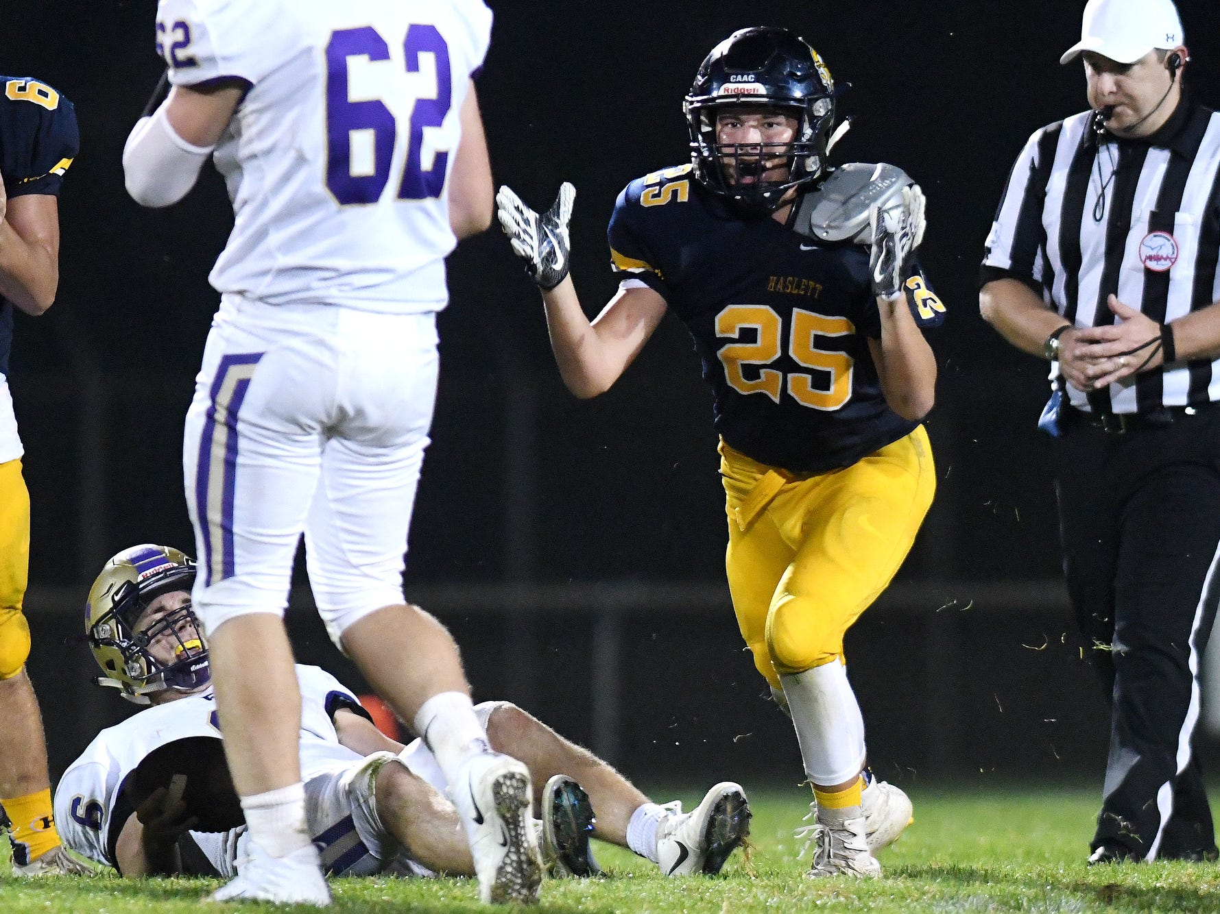Haslett's Chance Cook celebrates after recording a sack during the third quarter on Friday, Sept. 14, 2018, at Haslett High School.