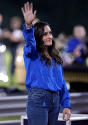 Former DeWitt student and Olympian Jordyn Wieber is honored and inducted to the Hall of Fame during halftime of a game against Holt, Friday, Sept. 14, 2018, in DeWitt, Mich.