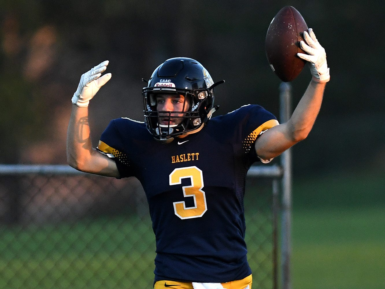 Haslett's Logan Cross celebrates his touchdown during the second quarter on Friday, Sept. 14, 2018, at Haslett High School.
