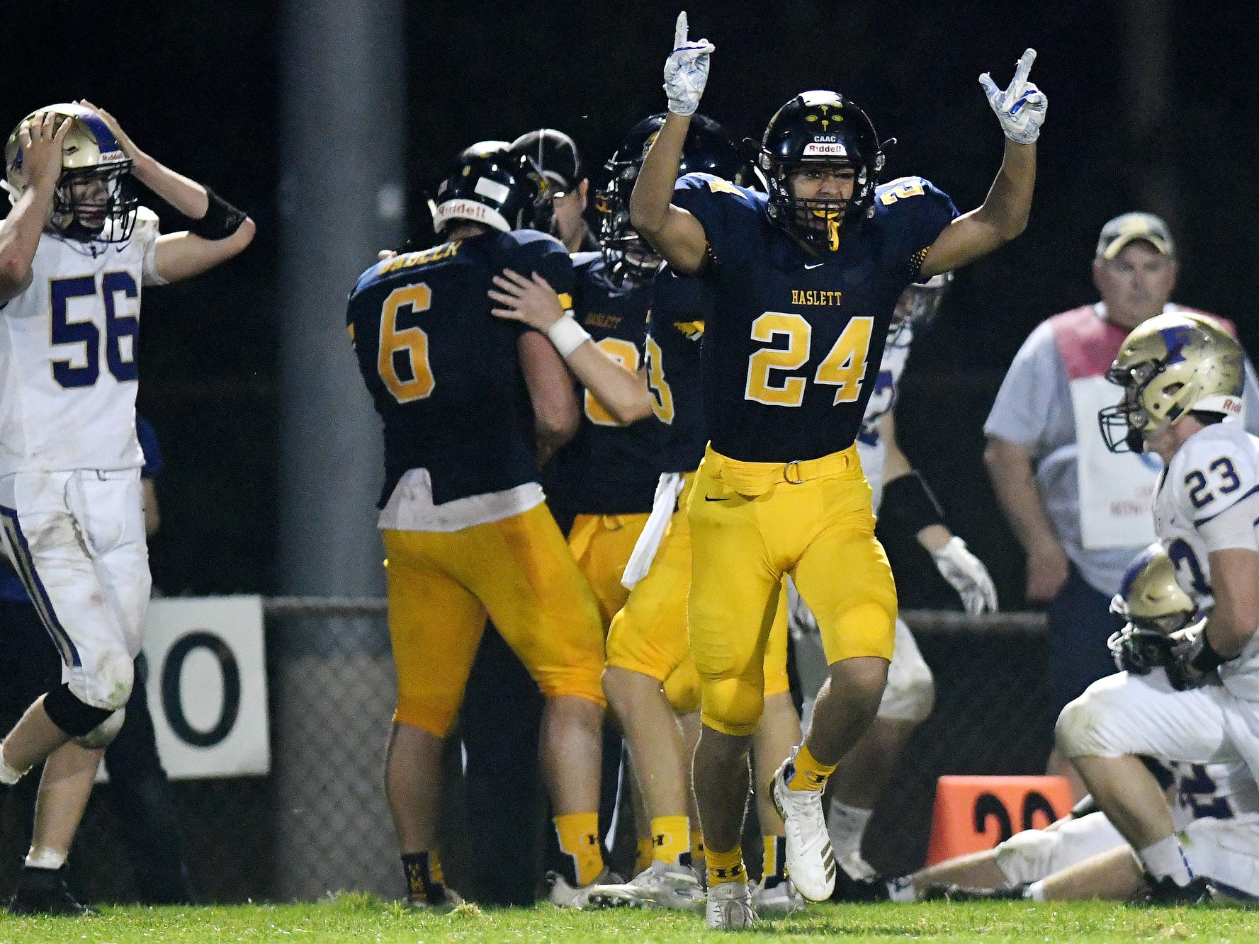 Haslett's Ty Andrades celebrates after the Vikings recovered a Fowlerville fumble during the fourth quarter on Friday, Sept. 14, 2018, at Haslett High School.