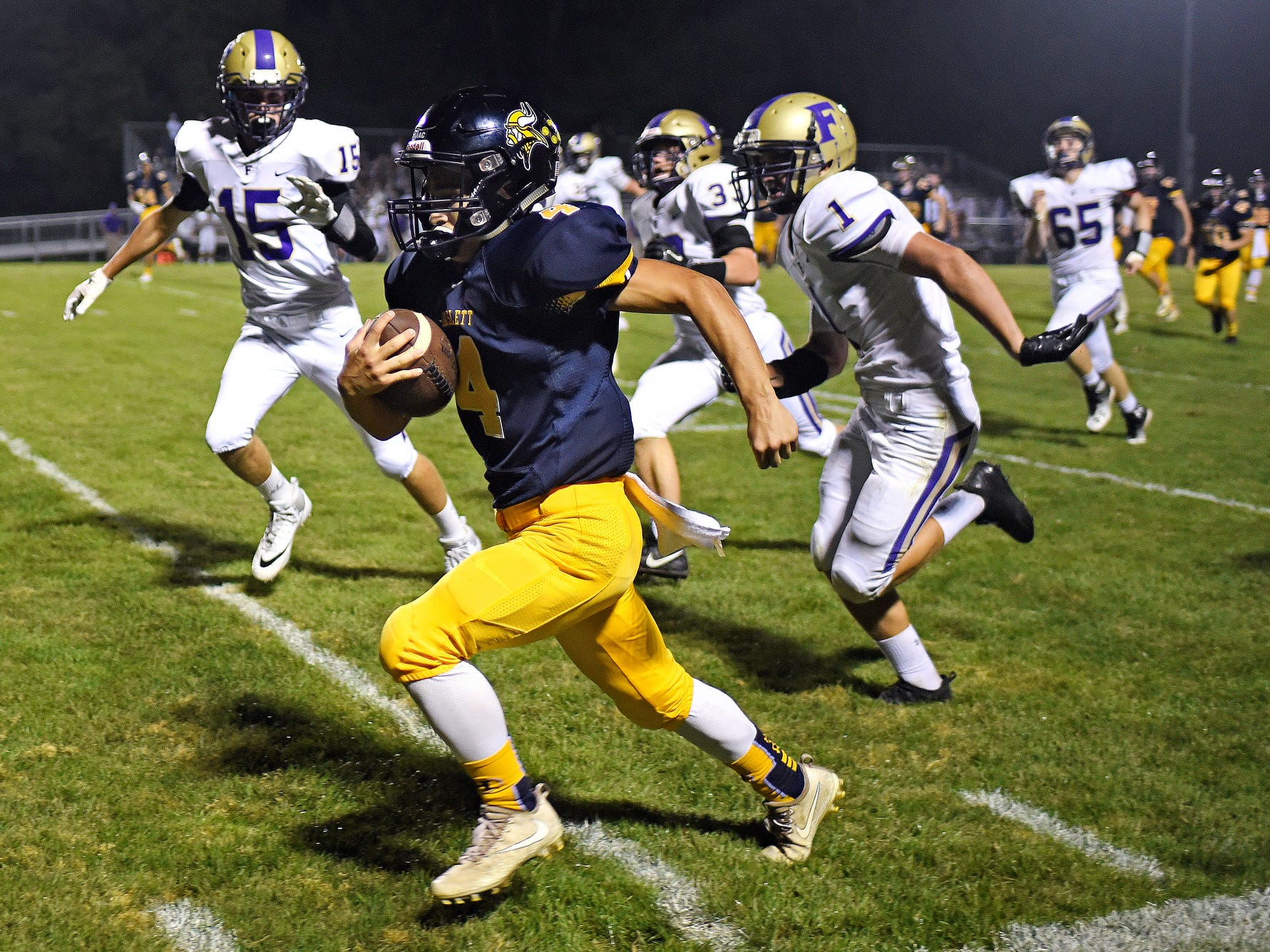 Haslett's Mateo Medrano outruns the Fowlerville defense on his way to a touchdown during the fourth quarter on Friday, Sept. 14, 2018, at Haslett High School.