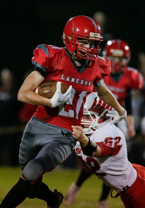 Lutheran's Evan Lischka runs for a gain against Oostburg during a Big East conference matchup at Manitowoc Lutheran High School Friday, September 14, 2018, in Manitowoc, Wis. Josh Clark/USA TODAY NETWORK-Wisconsin