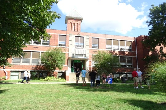 Hundreds of people toured the Bellville Elementary School, built in 1894, one last time Saturday. The building is slated to be torn down next spring.