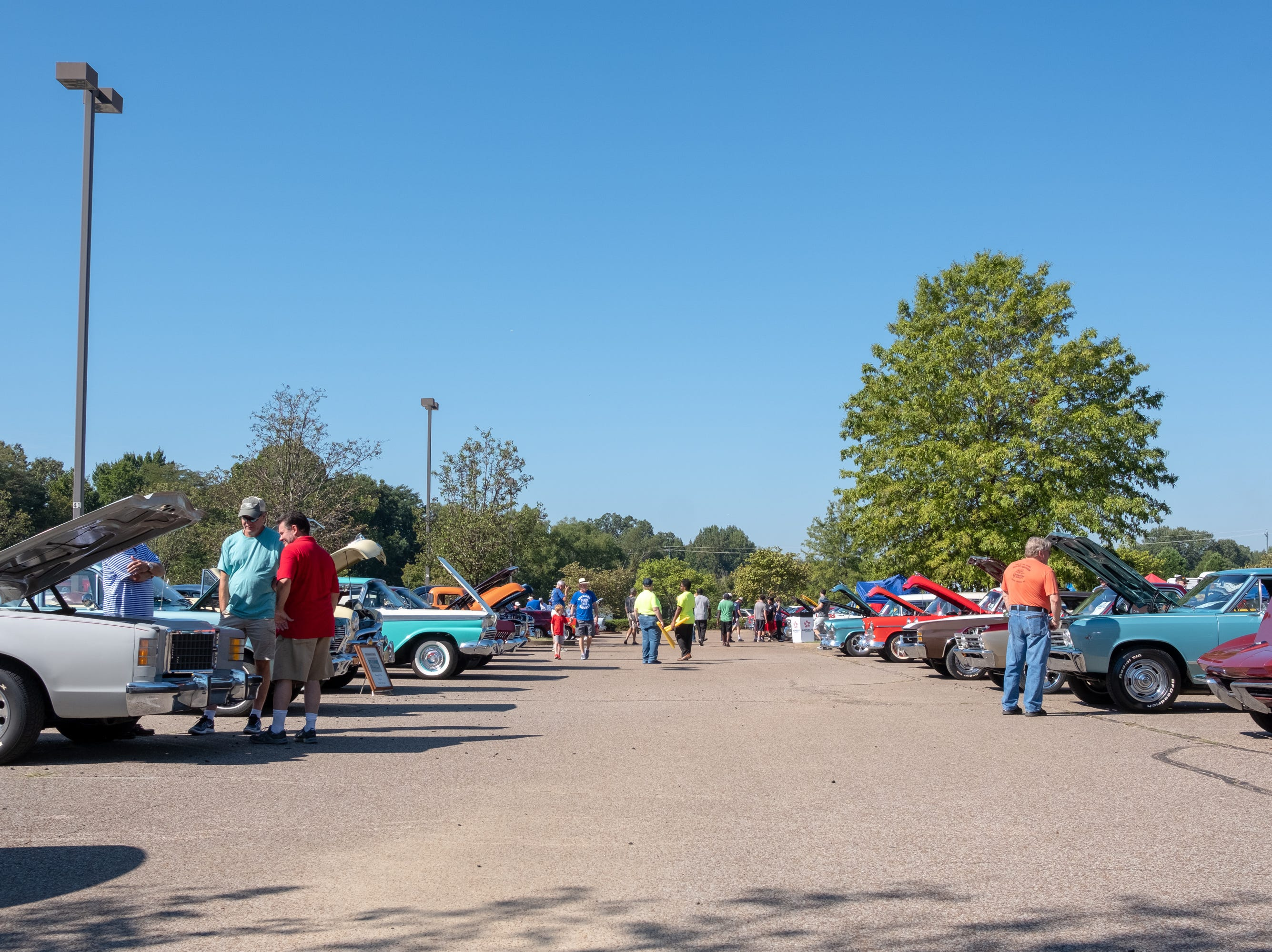 People gather to admire vehicles at the Collierville Classic Car Show on Saturday morning, Sept. 15, 2018.