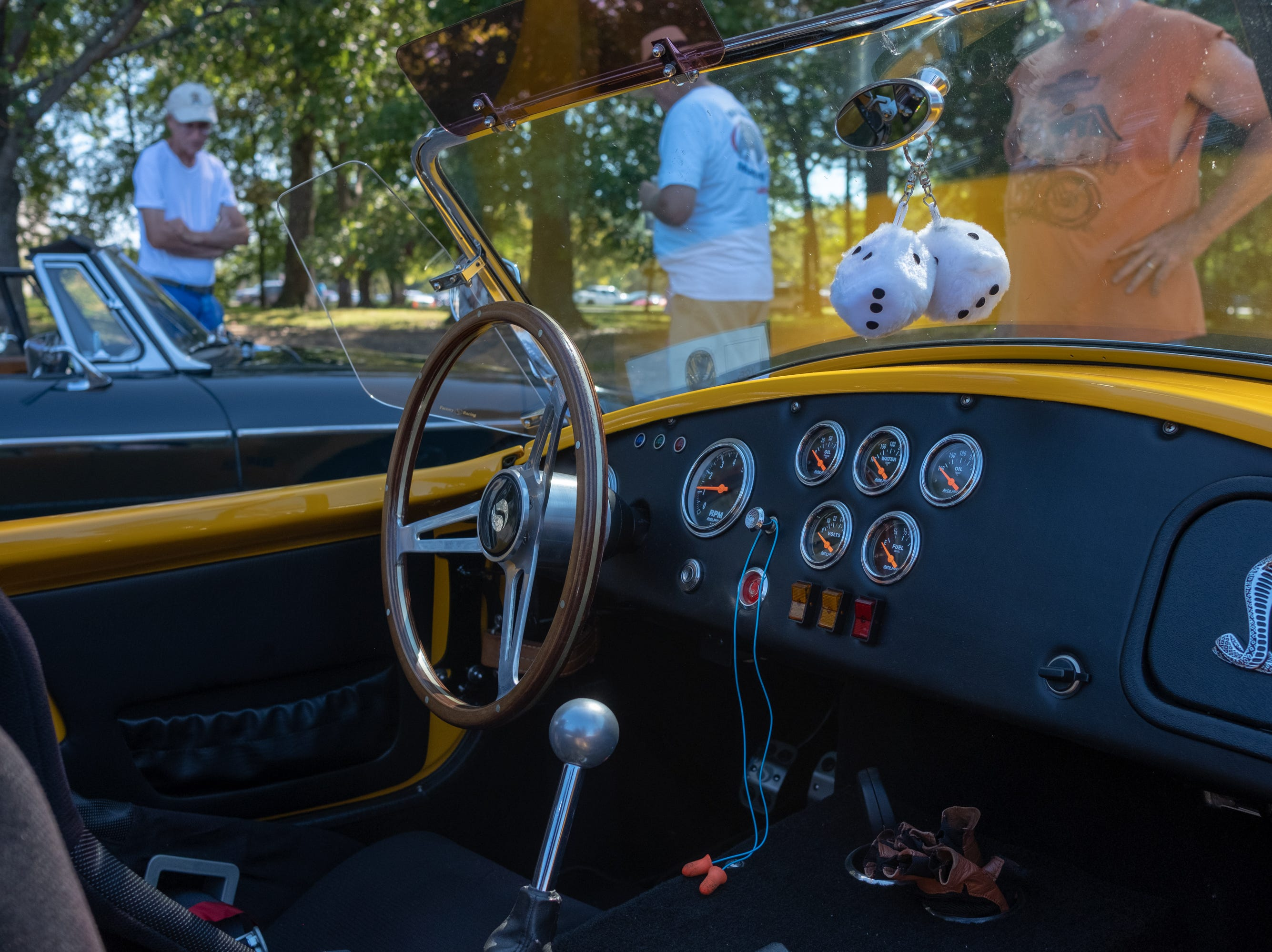 Earplugs hang near the the steering wheel of a 1965 Ford Cobra at the Collierville Classic Car Show on Sept. 15, 2018.