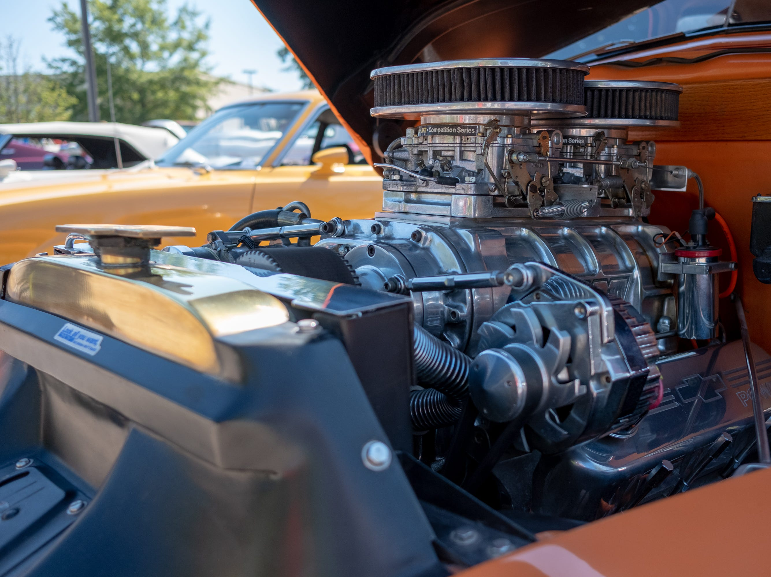 Vehicles at the Collierville Classic Car Show sport spotless engines on Sept. 15, 2018.