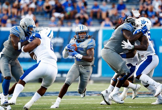 University of Memphis running back Darrell Henderson (middle) finds an open lane against the Georgia State University defense during action in Memphis, Tenn., Friday, September 14, 2018.