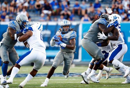 University of Memphis running back Darrell Henderson (middle) finds an open lane against the Georgia State University defense during action in Memphis, Tenn., Friday, September 14, 2018.