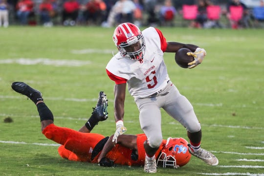 September 14 2018 - Germantown's BJ Gardner runs with the ball during Friday night's game at Southaven High School.