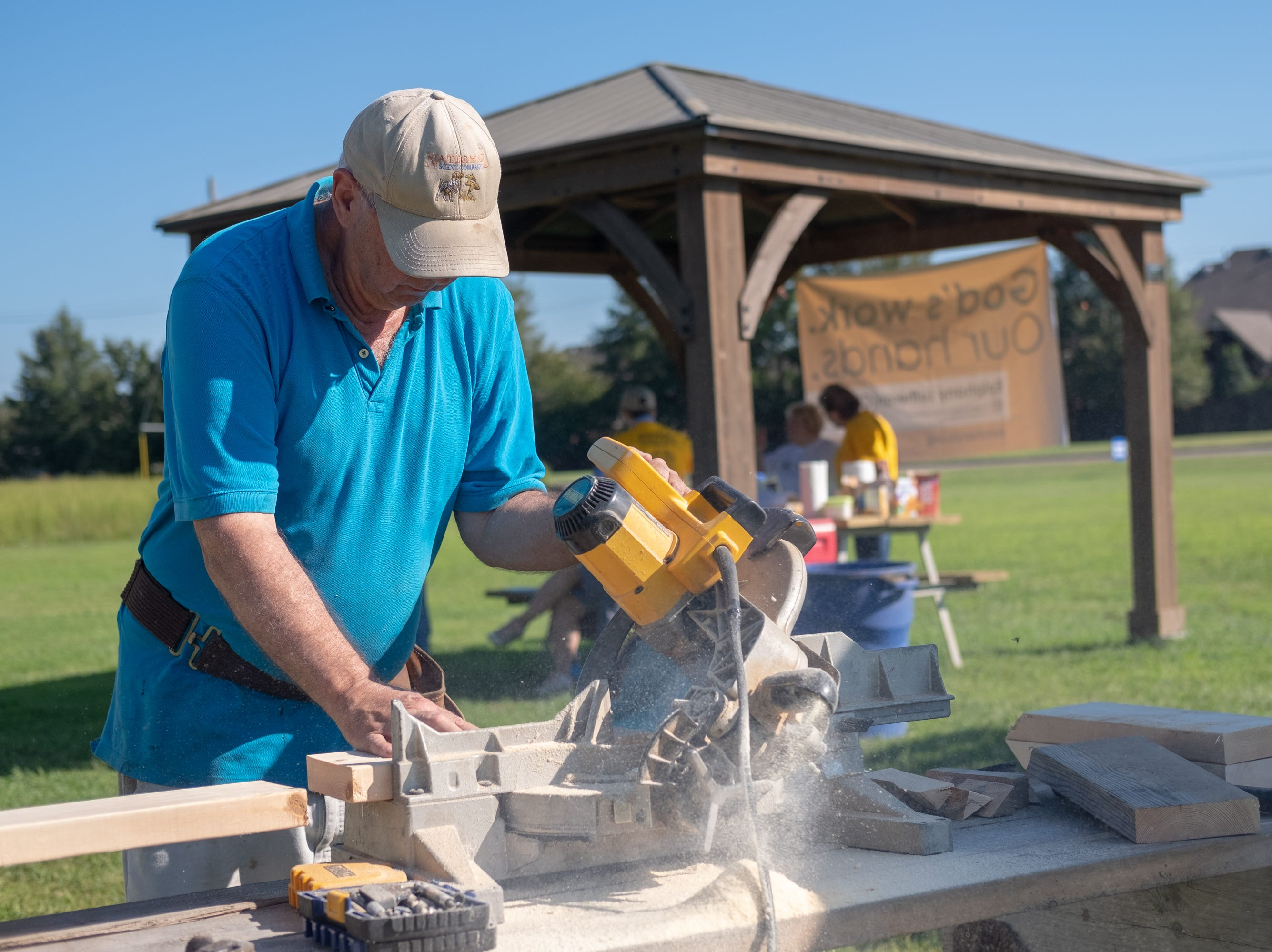 Greg Parker, with Epihany Lutheran Church, cuts wooden boards for a bird house on Saturday, Sept. 15, 2018.