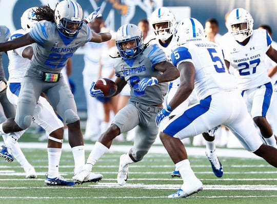 University of Memphis punter returner Pop Williams (middle) looks for a lane against Georgia State University during action in Memphis, Tenn., Friday, September 14, 2018.