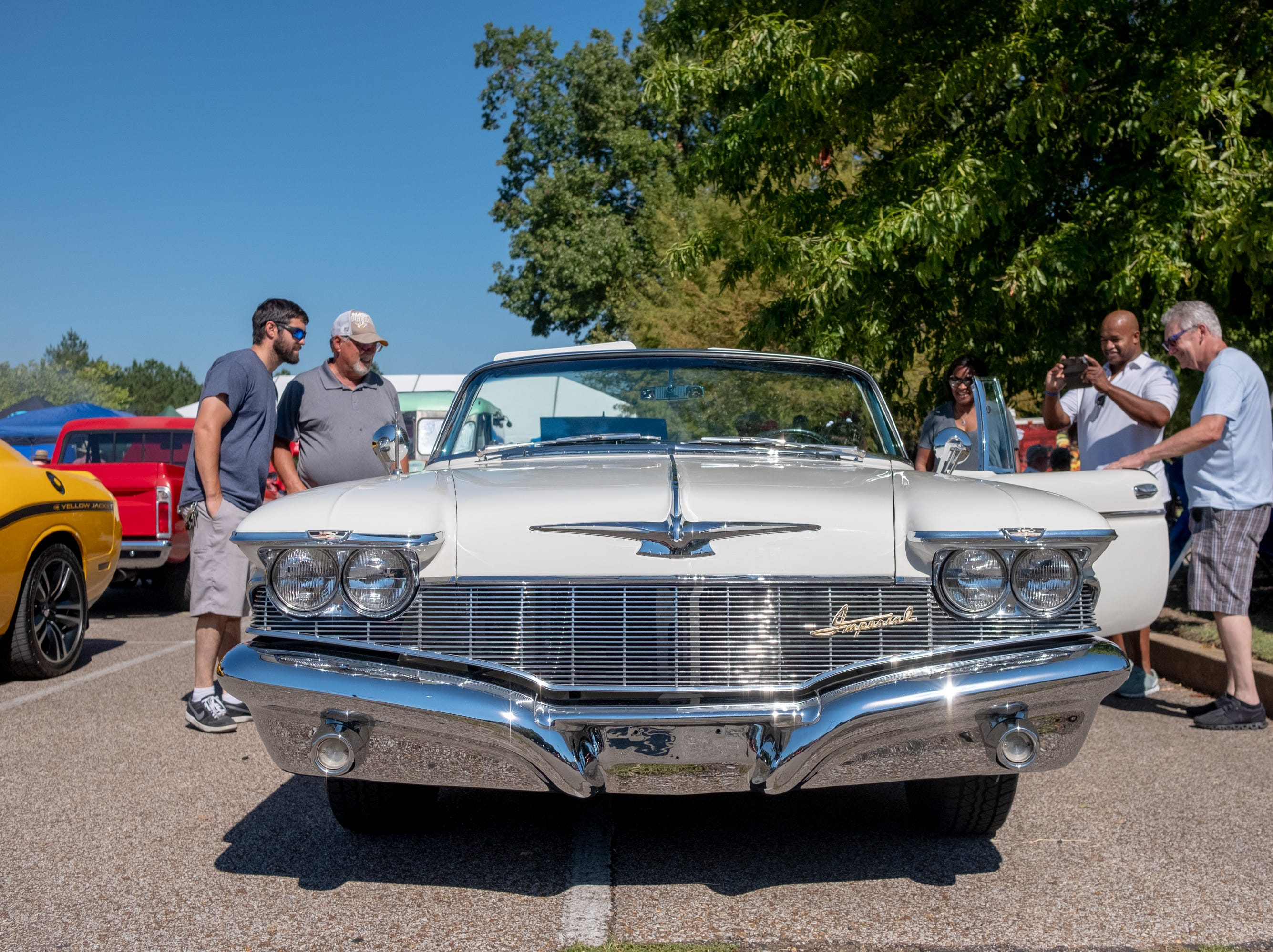 Visitors at the Collierville Classic Car Show admire vehicles and take photos on Sept. 15, 2018.