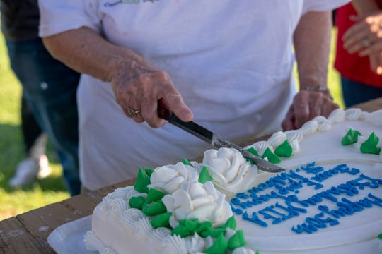 Linda Marks, MIFA's interfaith and community outreach officer, cuts the organization's 50th birthday cake.