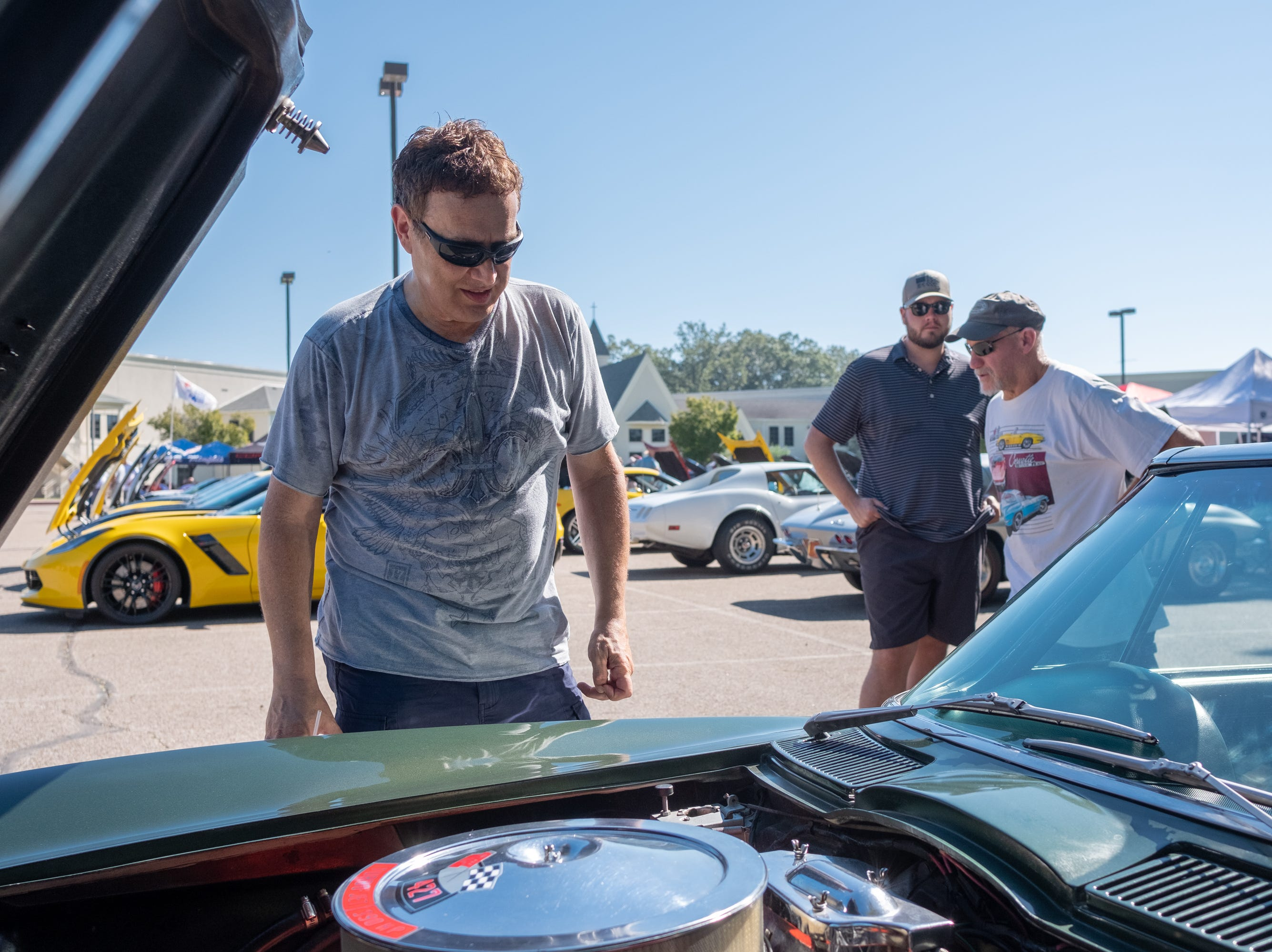 Jim Jeanis inspects the enging of a 1967 Corvette Stingray at the Collierville Classic Car Show on Sept. 15, 2018.
