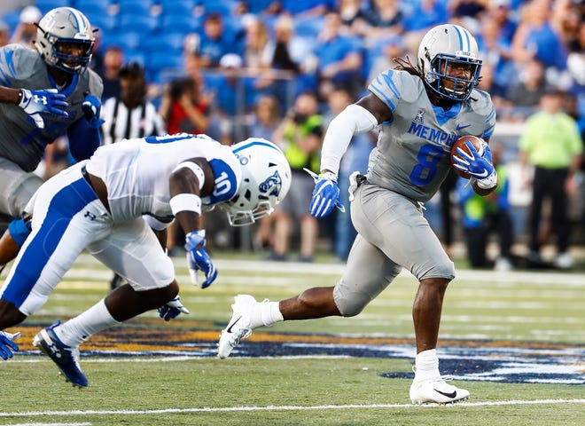 Memphis running back Darrell Henderson (right) runs by the Georgia State defense for a touchdown Friday. Henderson leads the nation in rushing despite averaging only 12 carries a game.