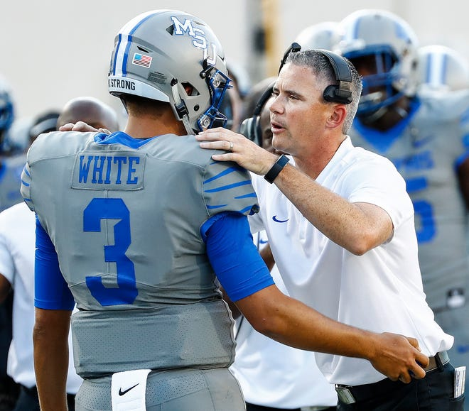 University of Memphis head coach Mike Norvell (right) chats with quarterback Brady White (left ) during action against Georgia State University  in Memphis, Tenn., Friday, September 14, 2018.