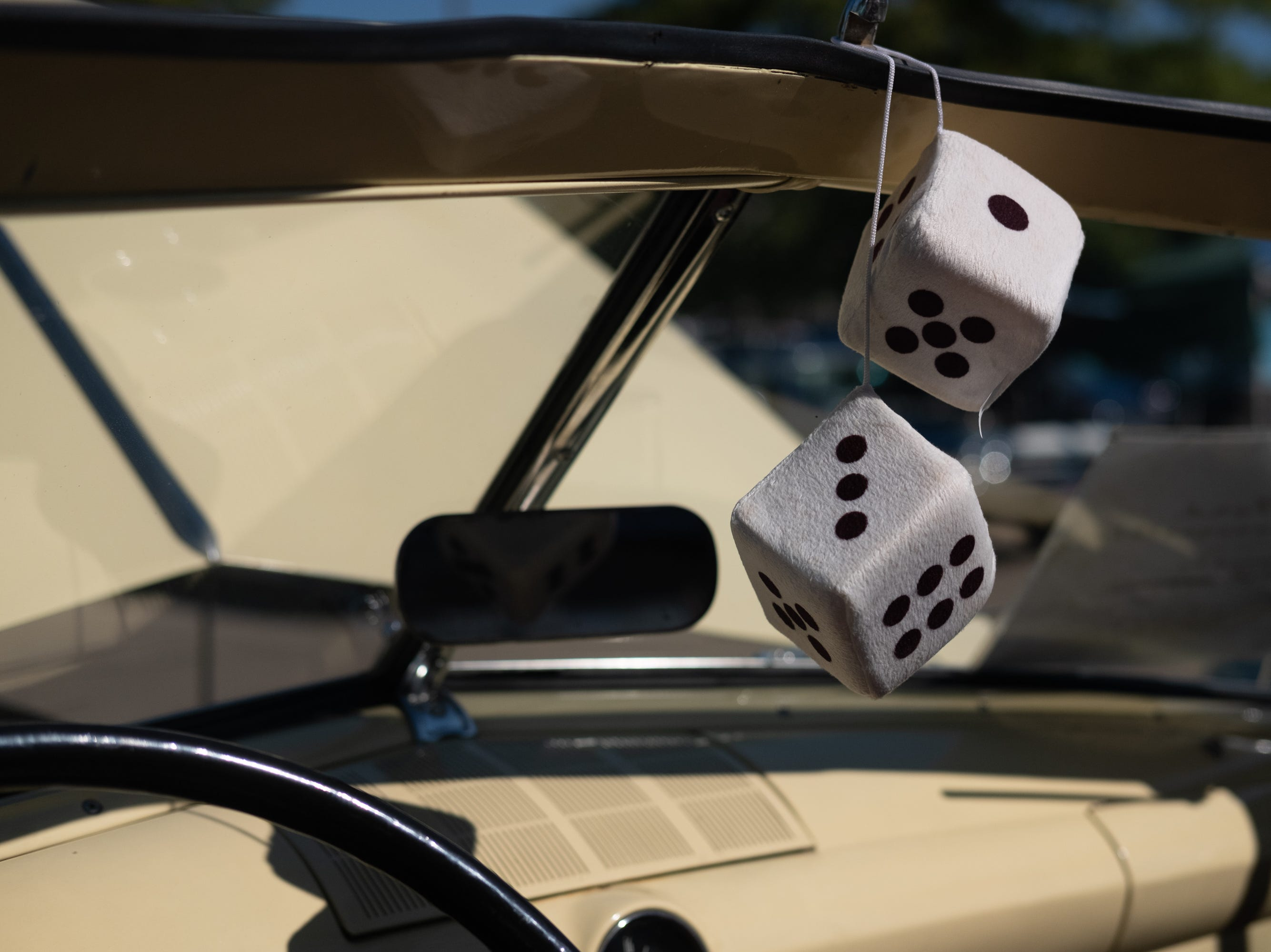 A pair of plush dice hang from a car at the Collierville Classic Car Show on Sept. 15, 2018.