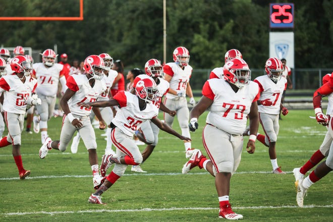 September 14 2018 - Germantown players take the field before the start of Friday night's game at Southaven High School.