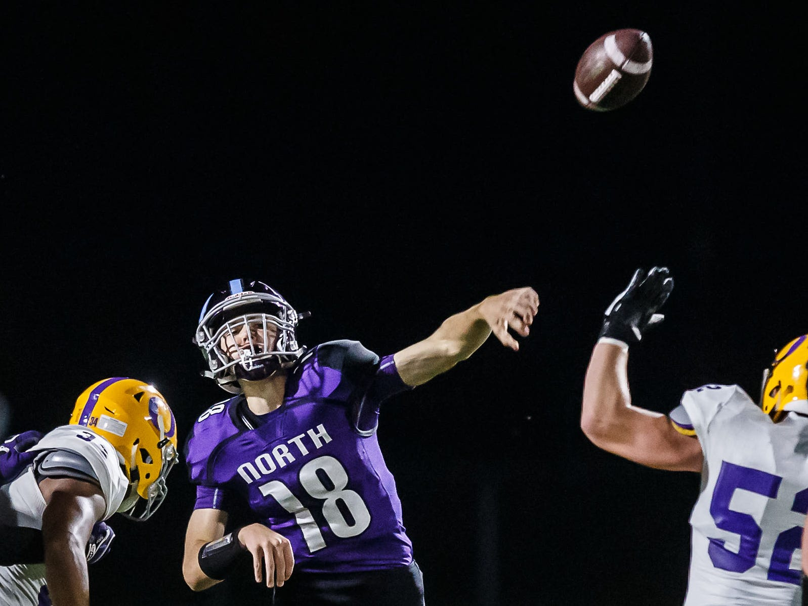 Waukesha North quarterback Johnny Kelliher (18) delivers a bomb during the game at home against Oconomowoc on Friday, Sept. 14, 2018.