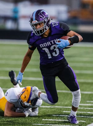 Waukesha North wide receiver Chimere Dike (13) races down the sideline during the game at home against Oconomowoc on Friday, Sept. 14, 2018.