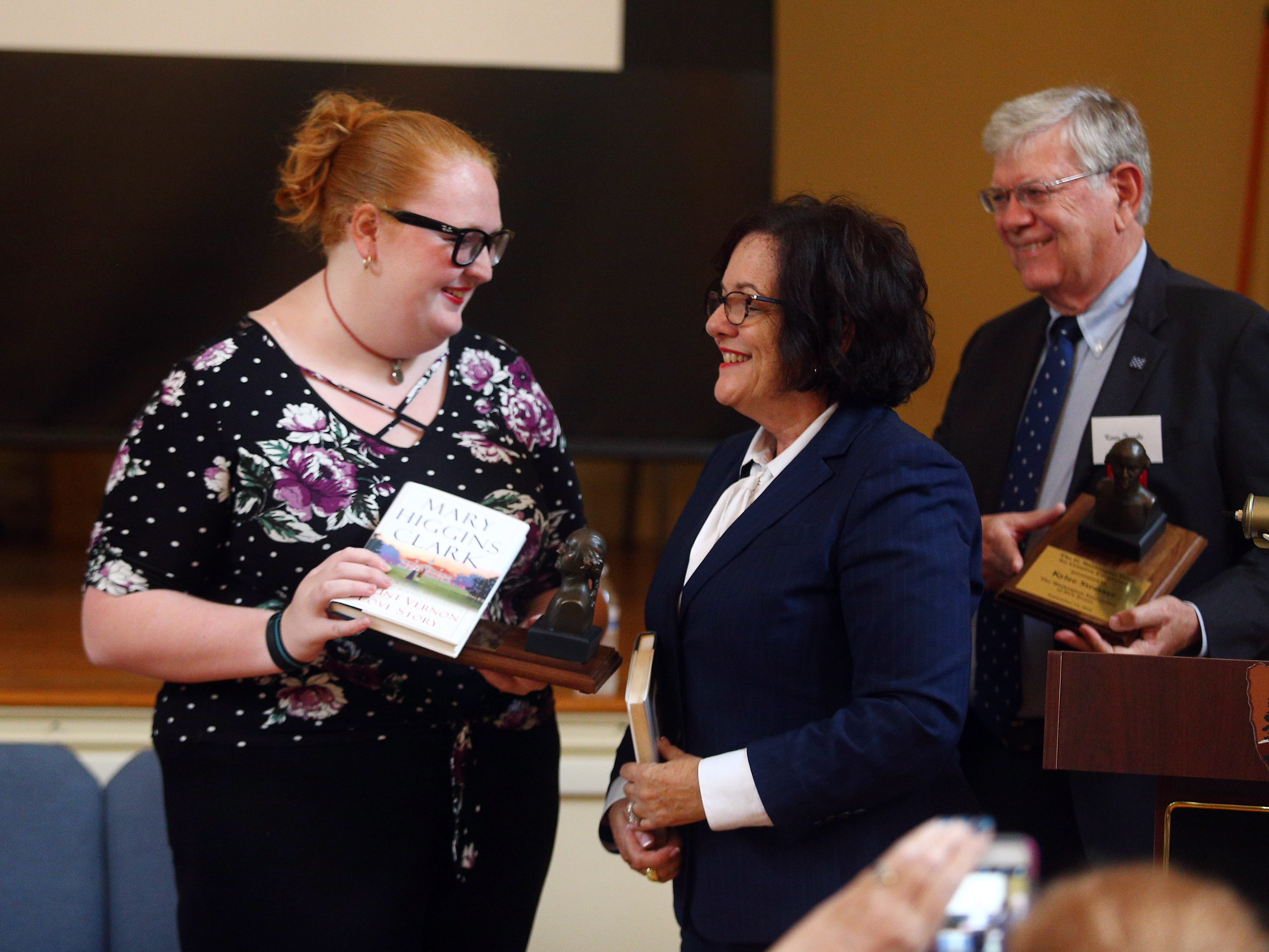 Morristown High School senior Katie Rosa accepts accept the George Washington Prize for Creative Excellence at Washington's Headquarters from Janice Selinger, Executive Director of the Crossroads of the American Revolution. Rosa and Kylee Strasser produced a film about historic Morristown. September 15, 2018, Morristown, NJ