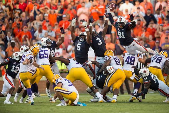 LSU's Cole Tracy (36) kicks the game winning field goal over the Auburn front line at Jordan-Hare Stadium in Auburn, Ala., on Saturday, Sept. 15, 2018. LSU defeated Auburn 22-21.