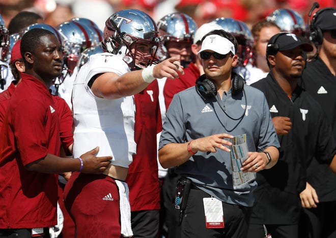 Sep 15, 2018; Lincoln, NE, USA; Troy Trojans head coach Neal Brown talks with quarterback Sawyer Smith (3) during the game against the Nebraska Cornhuskers in the first half at Memorial Stadium. Mandatory Credit: Bruce Thorson-USA TODAY Sports