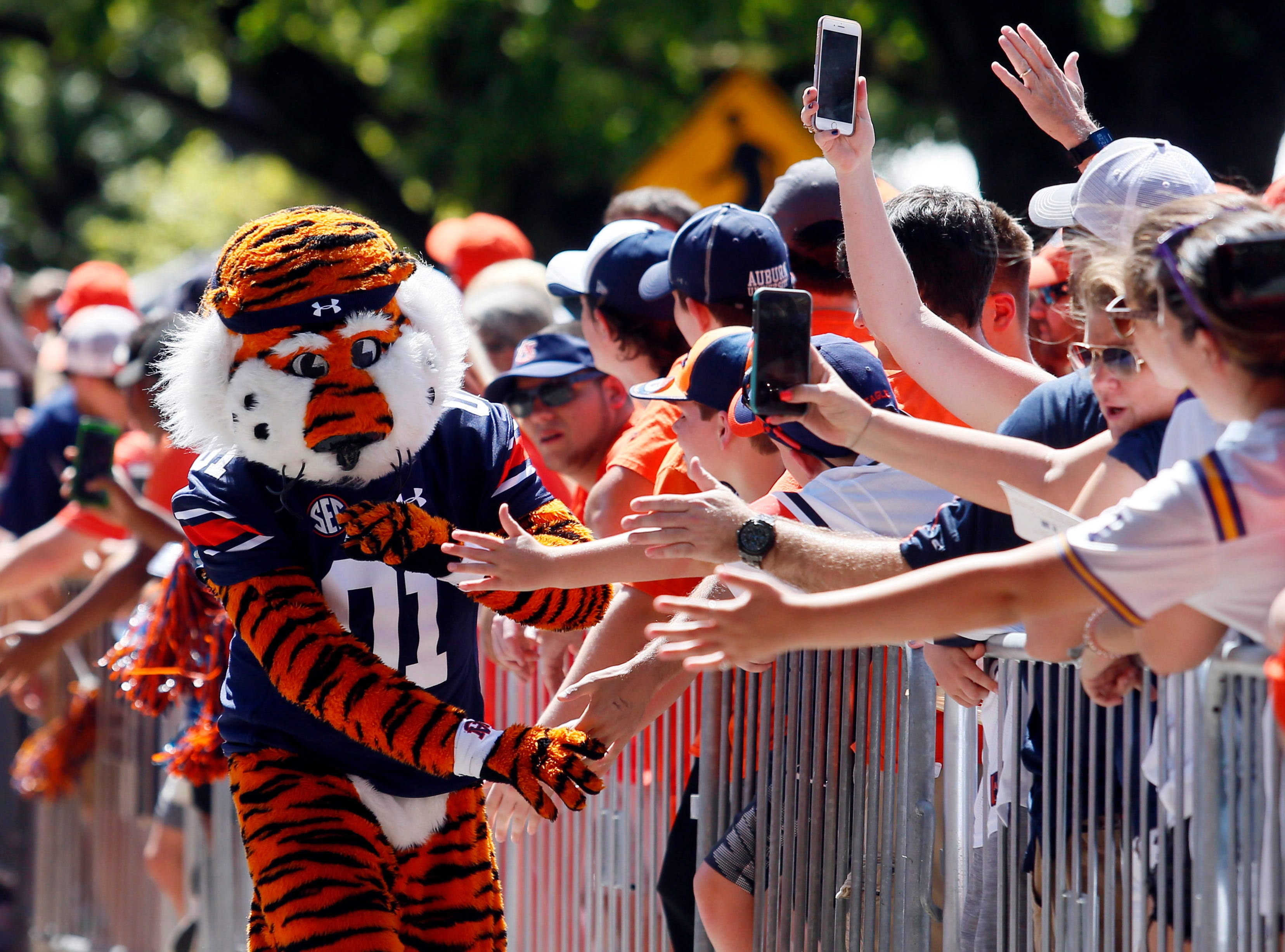 Sep 15, 2018; Auburn, AL, USA; Aubie, the Auburn Tigers mascot, goes through Tiger Walk before the game against the LSU Tigers at Jordan-Hare Stadium. Mandatory Credit: John Reed-USA TODAY Sports