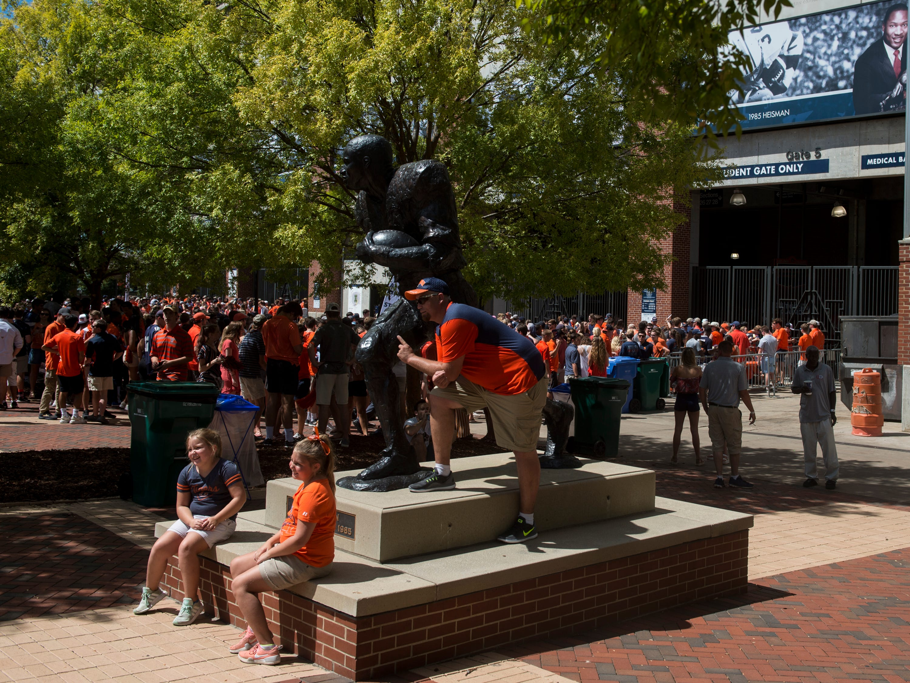 Baylee Acreman, 8, from left, her sister, Kenslee, 10, and dad, Jesse, pose with the Bo Jackson statue outside Jordan-Hare Stadium in Auburn, Ala., on Saturday, Sept. 15, 2018.