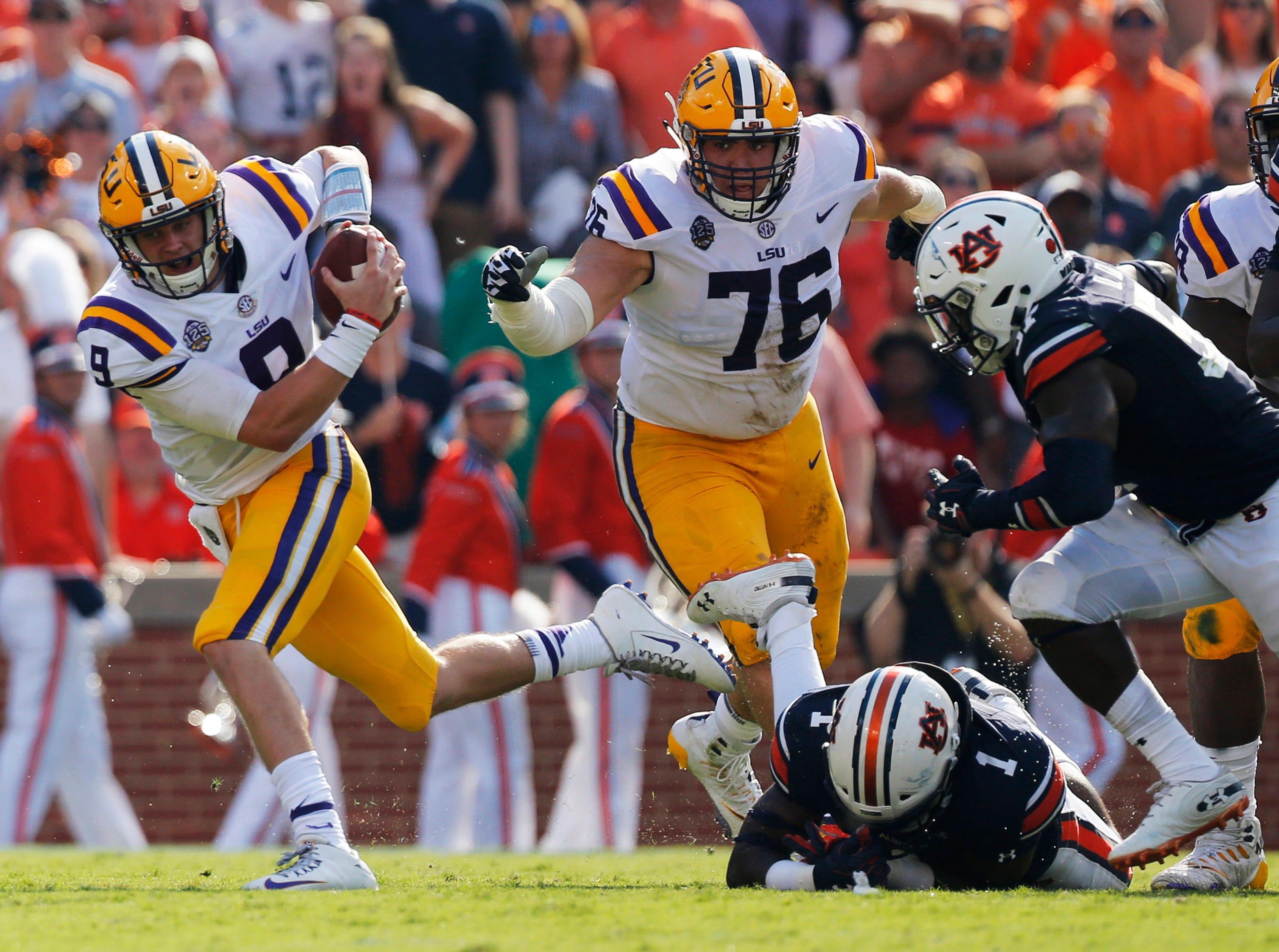 Sep 15, 2018; Auburn, AL, USA; LSU Tigers quarterback Joe Burrow (9) scrambles against the Auburn Tigers during the second quarter at Jordan-Hare Stadium. Mandatory Credit: John Reed-USA TODAY Sports