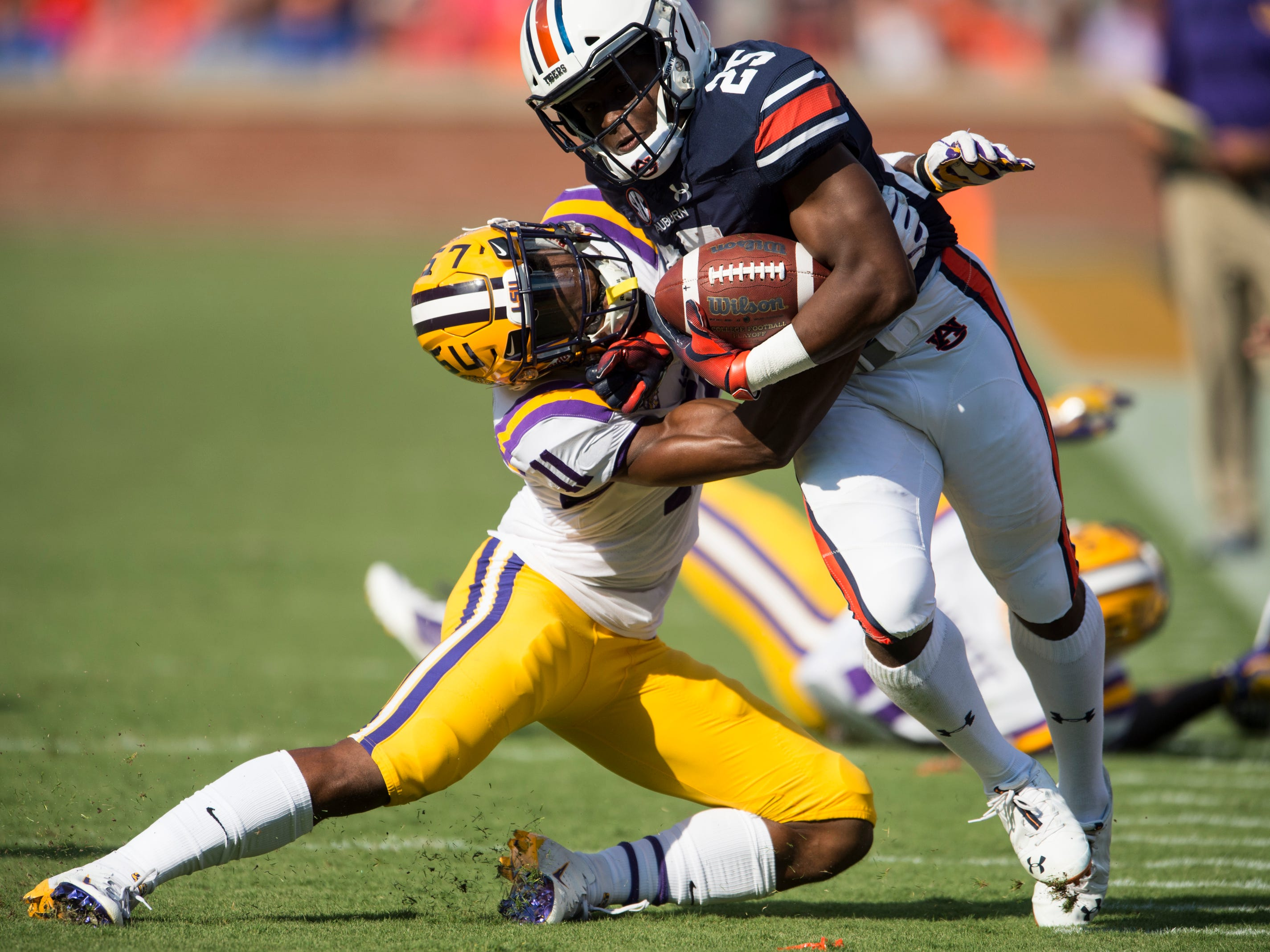 Auburn's Shaun Shivers (25) is shoved out of bounds by LSU's Terrence Alexander (11) at Jordan-Hare Stadium in Auburn, Ala., on Saturday, Sept. 15, 2018. Auburn leads LSU 14-10 at halftime.