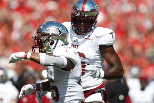 Sep 15, 2018; Lincoln, NE, USA; Troy Trojans running back B.J. Smith (26) celebrates his touchdown with linebacker Walter Pritchett (46) against the Nebraska Cornhuskers in the first half at Memorial Stadium. Mandatory Credit: Bruce Thorson-USA TODAY Sports