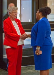Quesha Starks, Booker T. Washington's principal, greets Gov. Kay Ivey at a brunch for first responders and volunteers who helped during and after a fire.