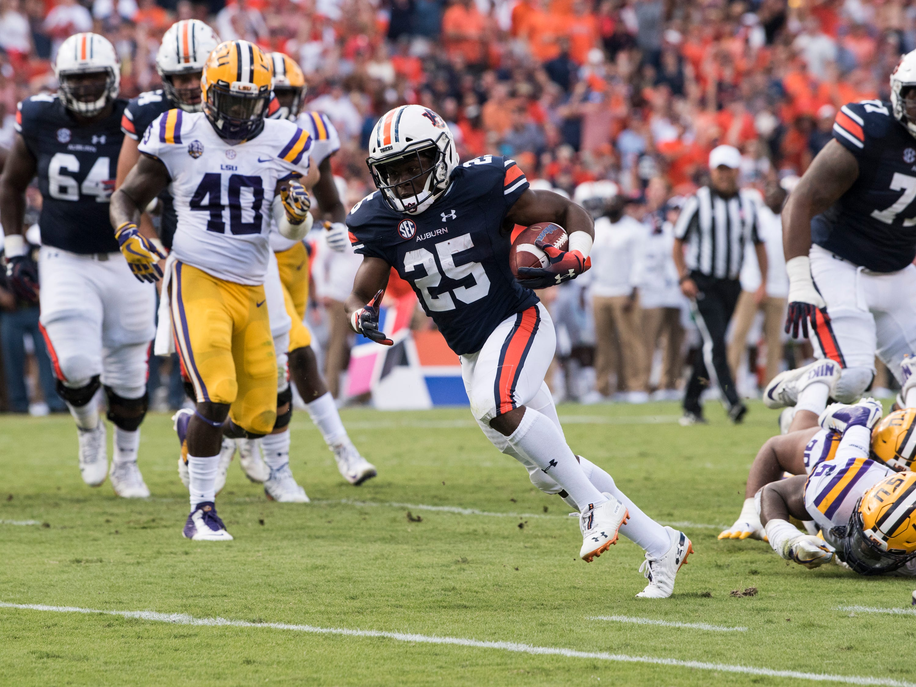 Auburn's Shaun Shivers (25) sheds defenders as he runs into the end zone for a touchdown against LSU at Jordan-Hare Stadium in Auburn, Ala., on Saturday, Sept. 15, 2018. Auburn leads LSU 14-10 at halftime.