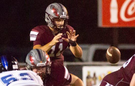 Alabama Christian's Reece Solar puts his hands up to catch the snap during the first quarter.