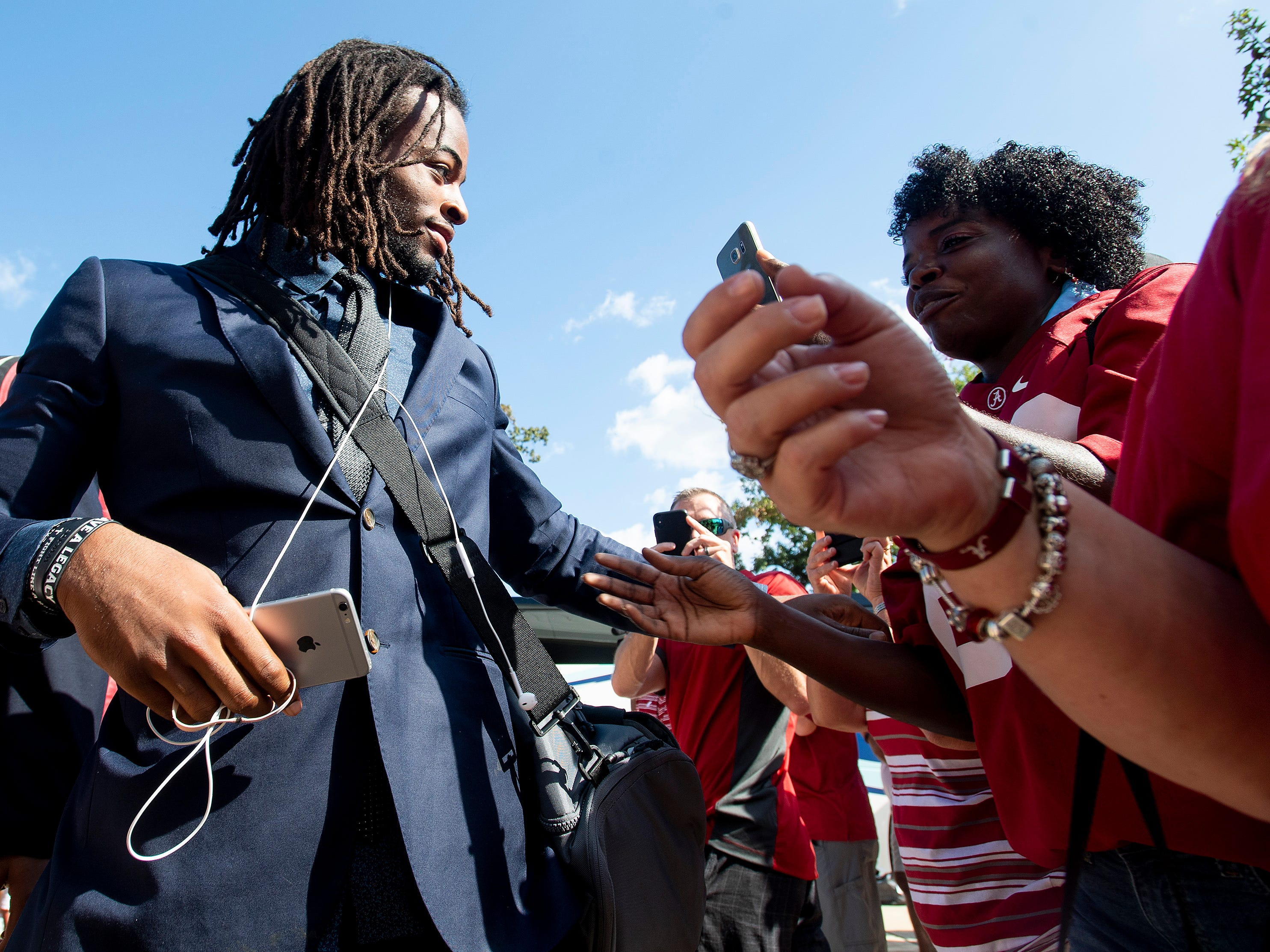 Alabama running back Najee Harris (22) greets his mother Tianna Hicks as the Alabama football team arrives on the Ole Miss campus in Oxford, Ms., on Saturday September 15, 2018.