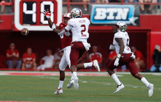 Sep 15, 2018; Lincoln, NE, USA; Troy Trojans linebacker Tron Folsom (2) breaks up a pass intended for Nebraska Cornhuskers wide receiver Stanley Morgan Jr. (8) in the first half at Memorial Stadium. Mandatory Credit: Bruce Thorson-USA TODAY Sports