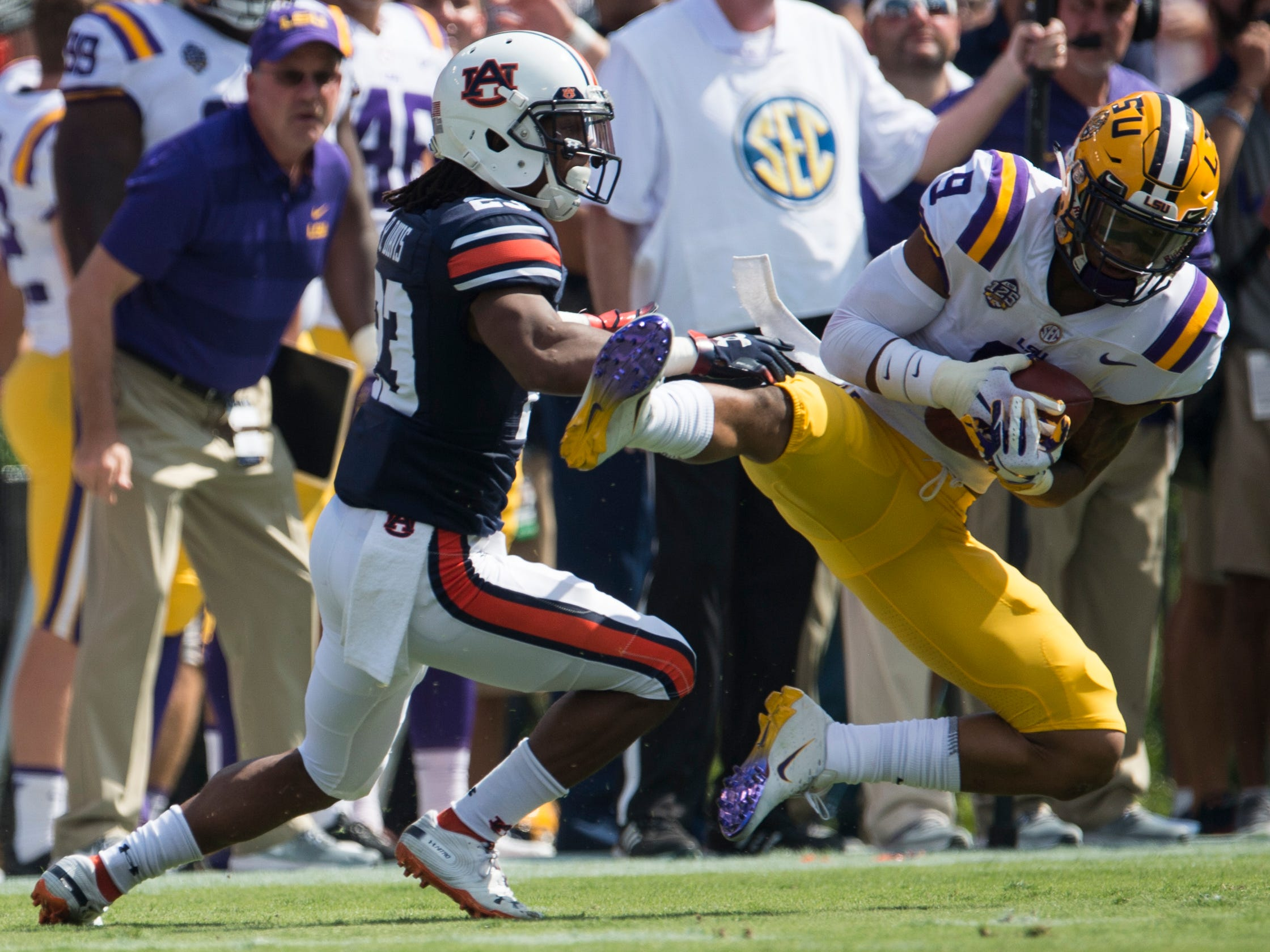 LSU's Grant Delpit (9) intercepts the ball intended for Auburn's Ryan Davis (23) at Jordan-Hare Stadium in Auburn, Ala., on Saturday, Sept. 15, 2018. Auburn leads LSU 14-10 at halftime.
