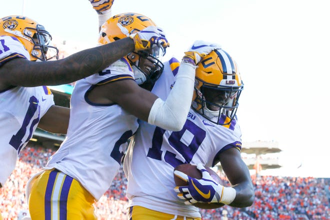 Sep 15, 2018; Auburn, AL, USA; LSU Tigers receiver Derrick Dillon (19) celebrates with Justin Jefferson (2) and Dee Anderson (11) after scoring a touchdown against the Auburn Tigers in the fourth quarter at Jordan-Hare Stadium. Mandatory Credit: John Reed-USA TODAY Sports
