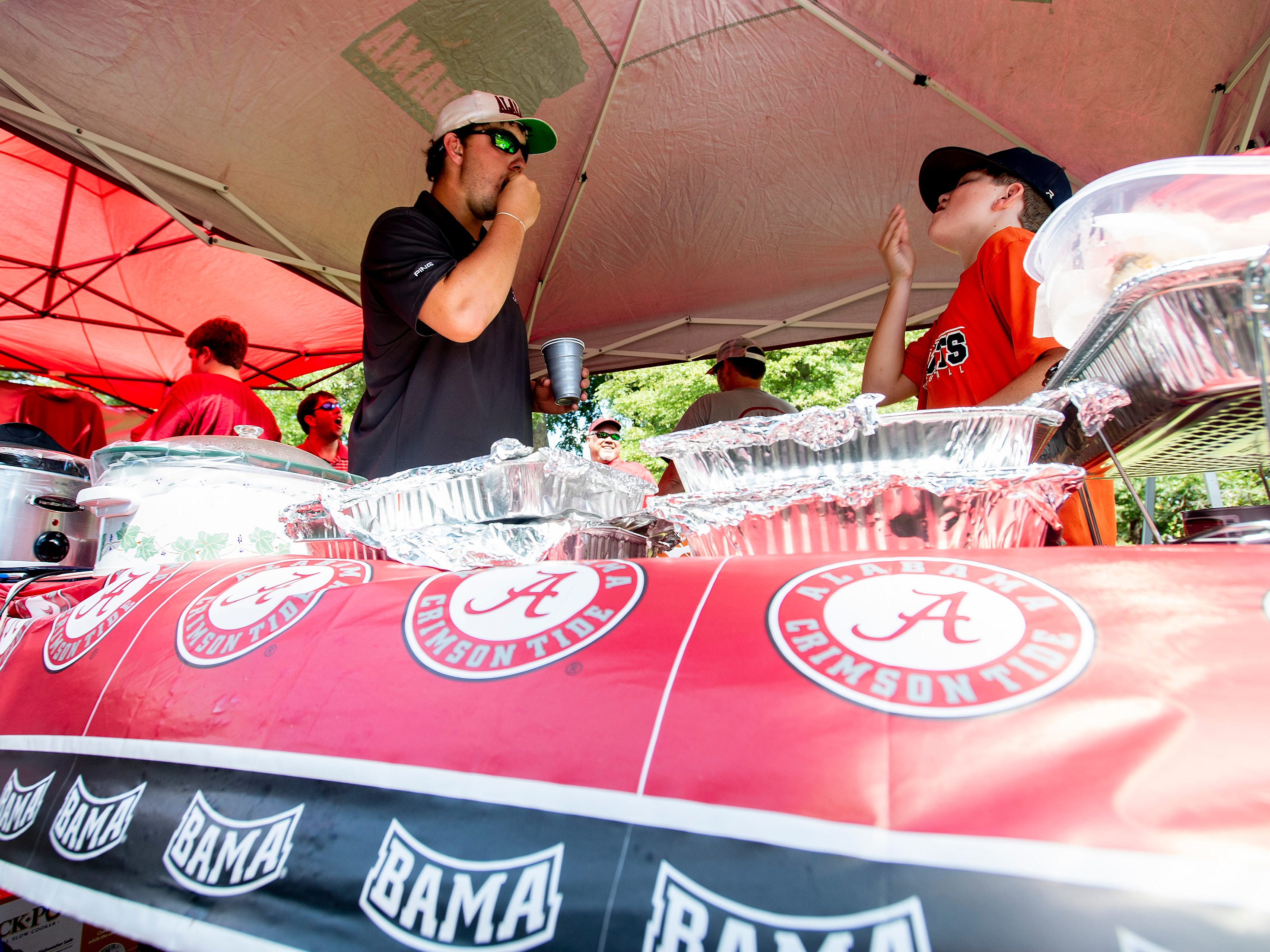 Alabama fans tailgate on the Ole Miss campus in Oxford, Ms., on Saturday September 15, 2018.
