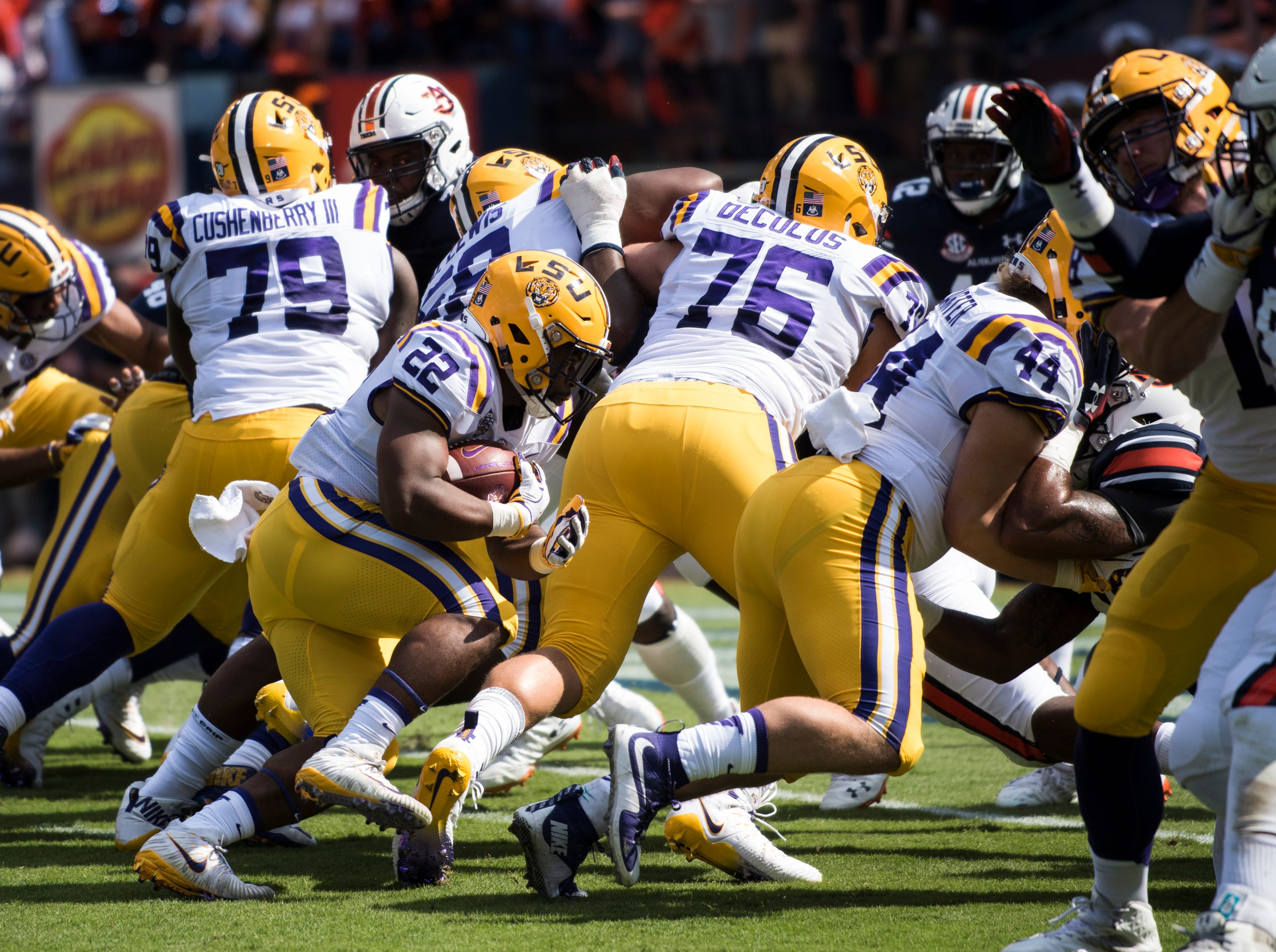 LSU's Clyde Edwards-Helaire (22) pushes behind his line for a touchdown run against  Auburn at Jordan-Hare Stadium in Auburn, Ala., on Saturday, Sept. 15, 2018. Auburn leads LSU 14-10 at halftime.