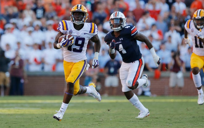 Sep 15, 2018; Auburn, AL, USA; LSU Tigers receiver Derrick Dillon (19) catches a pass and scores a touchdown against the Auburn Tigers during the fourth quarter at Jordan-Hare Stadium. Mandatory Credit: John Reed-USA TODAY Sports