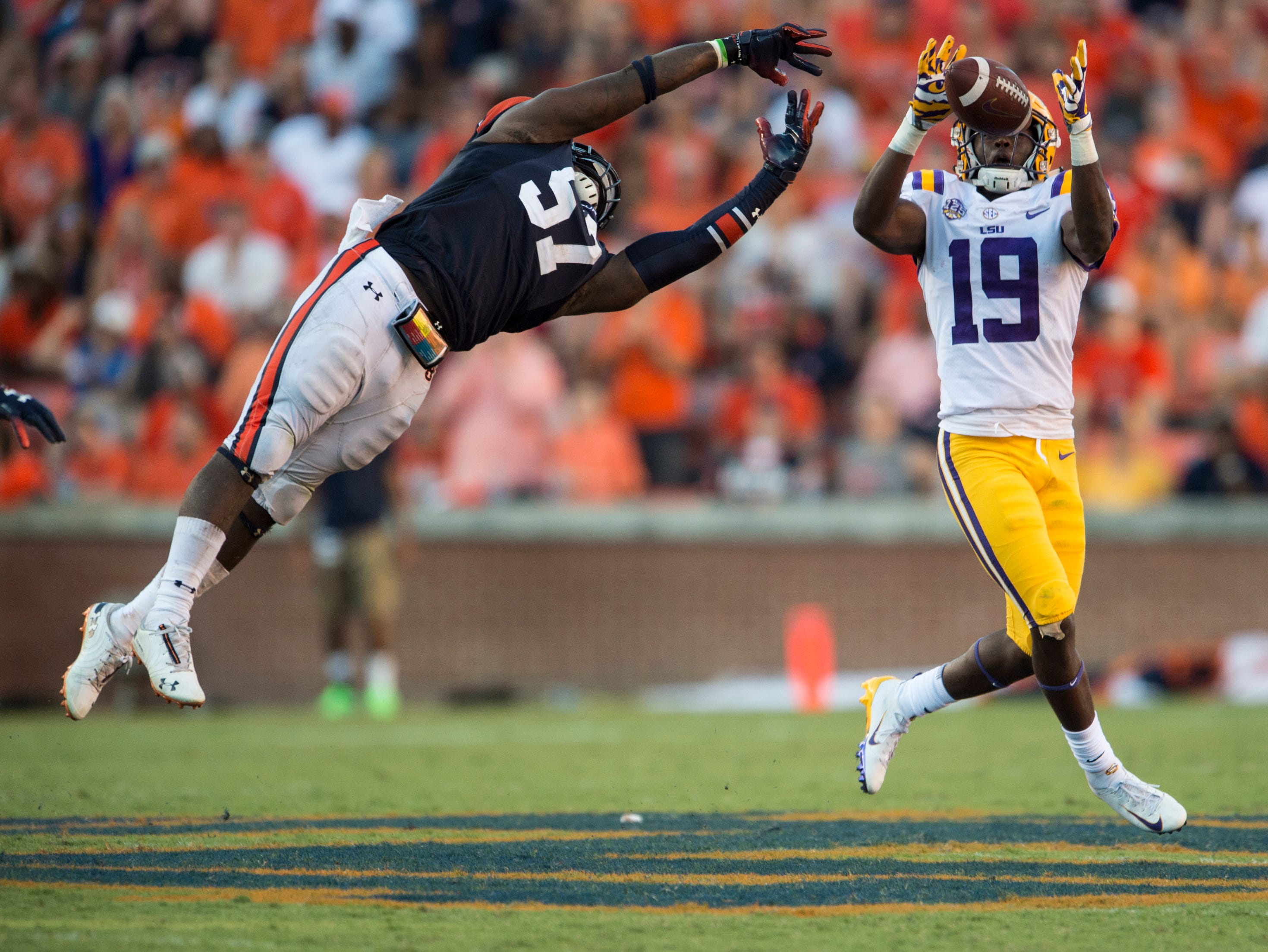 LSU's Derrick Dillon (19) catches a pass and runs it in for a touchdown to but LSU within 3 points against  Auburn at Jordan-Hare Stadium in Auburn, Ala., on Saturday, Sept. 15, 2018. LSU defeated Auburn 22-21.
